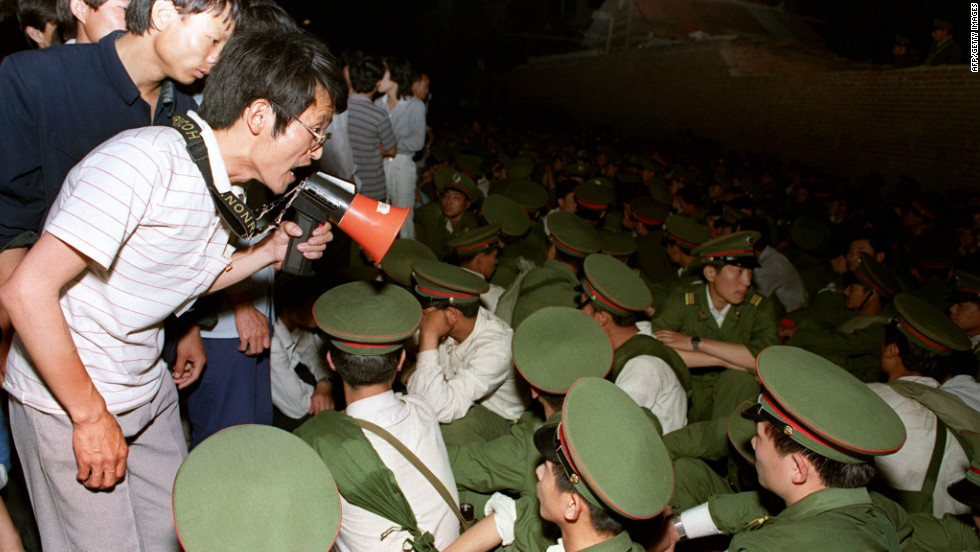 A student demands People's Liberation Army soldiers leave as crowds flood into central Beijing on June 3, 1989.
