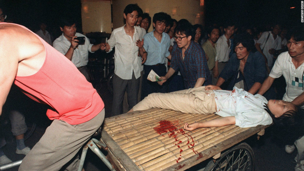 A girl wounded during the clash near Tiananmen Square is carried out on a cart.