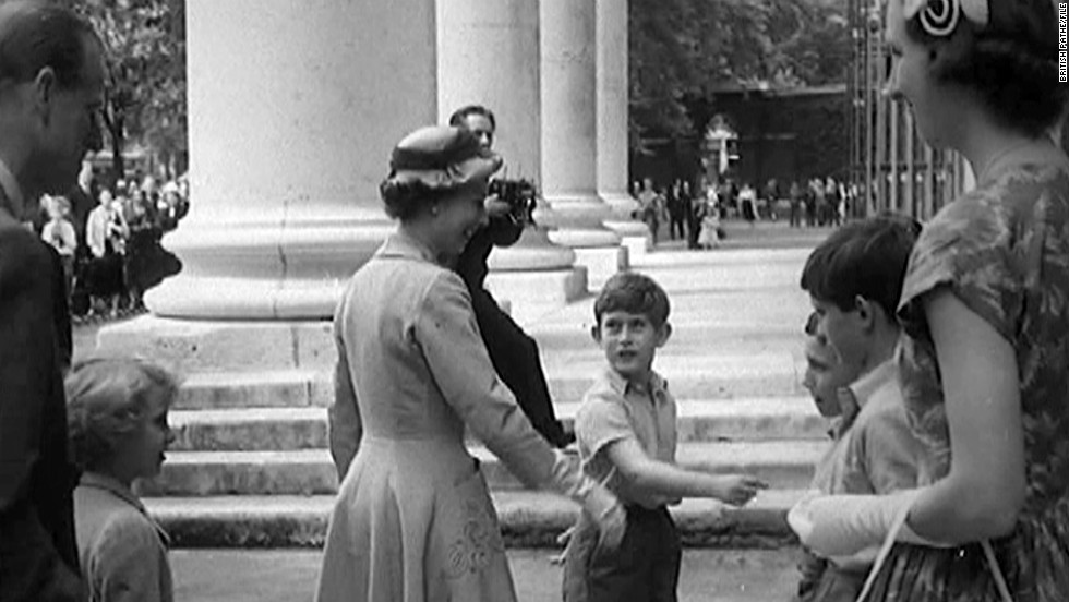 Prince Charles introducing his mother, The Queen, to his school teachers and fellow pupils at Sports Day, Hill House School, West London in the summer of 1957.