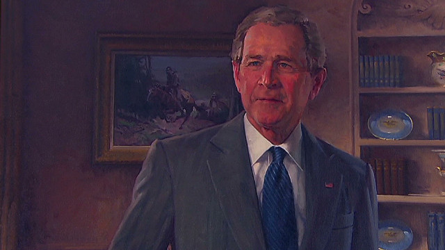 Bushes have fun at portrait unveiling