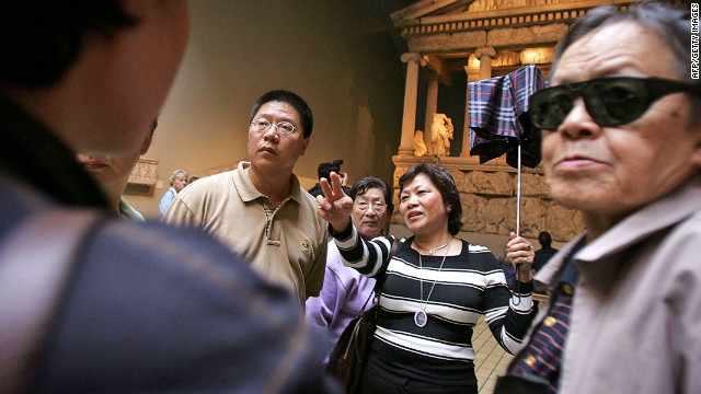 Chinese tourists in the British Museum. As all savvy travelers know: do not open umbrellas indoors while in Britain.