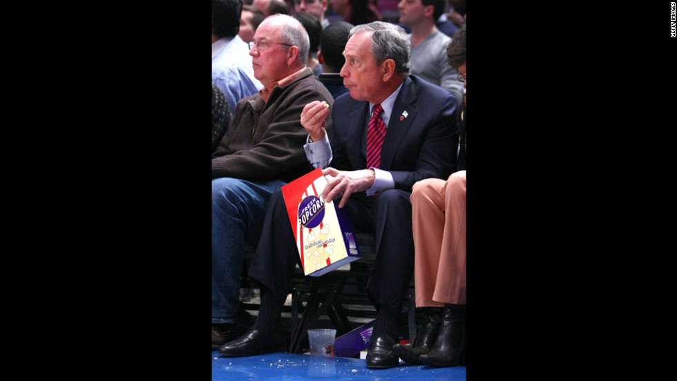 The mayor takes in the New Jersey Nets-New York Knicks game with a little popcorn at Madison Square Garden in March 2009.