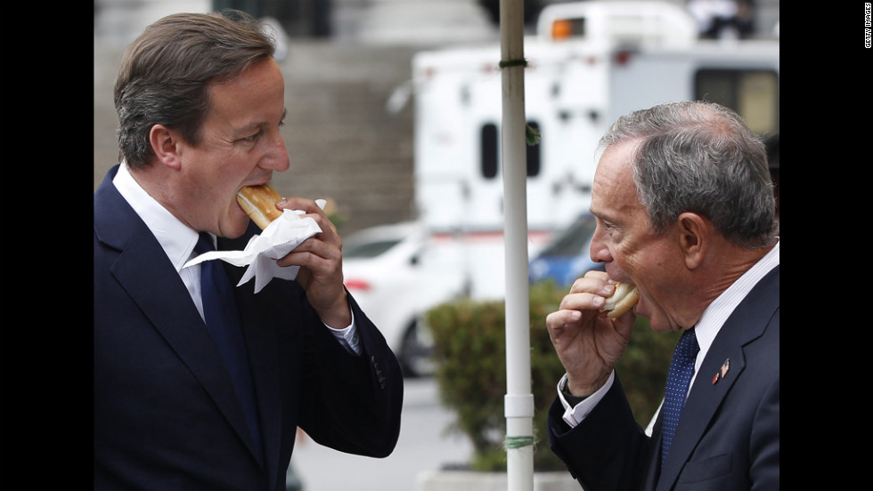 Bloomberg faces off with British Prime Minister David Cameron over hot dogs outside Penn Station in New York in 2010.