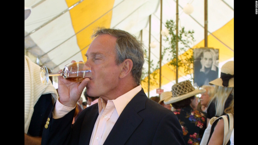 Bloomberg, then a mayoral candidate, has a glass of wine at the Hampton Classic Horse Show in Bridgehampton, New York, in September 2001.