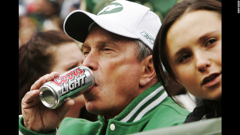 Sweeping public health initiatives have been a trademark of New York Mayor Michael Bloomberg's administration. A ban on the sale of large-size sodas and other sugary beverages at restaurants and food carts is the latest proposal. Here's a look at the mayor's eating and drinking habits through the years. He sips a beer during a 2004 New York Jets-San Francisco 49ers game at the Meadowlands with daughter Georgina at his side.