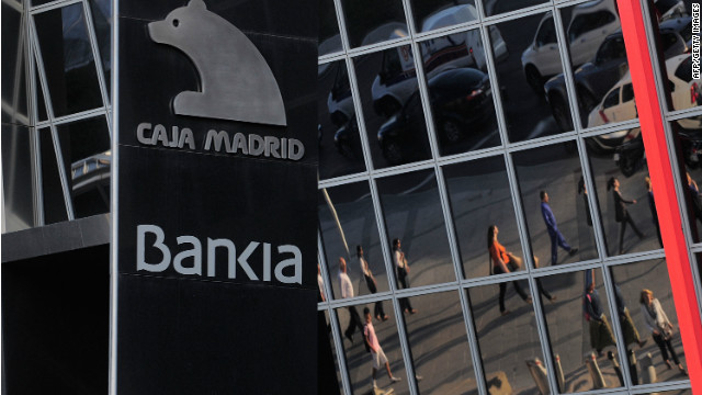 MADRID, SPAIN - MAY 29: Commuters are reflected on the headquarters of Bankia SA on May 29, 2012 in Madrid, Spain. Spanish borrowing costs have increased after the government announced a rescue plan for Bankia involving more public debt. (Photo by Denis Doyle/Getty Images)