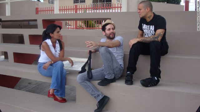 CNN en Espanol anchor Claudia Palacios talks with Eduardo Cabra and Rene Perez, members of the band Calle 13.