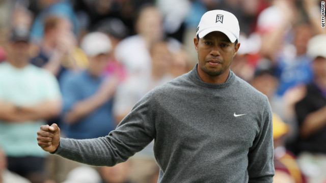 Tiger Woods celebrates a birdie putt on his first hole of the third round at Muirfield Village Golf Club on Saturday.