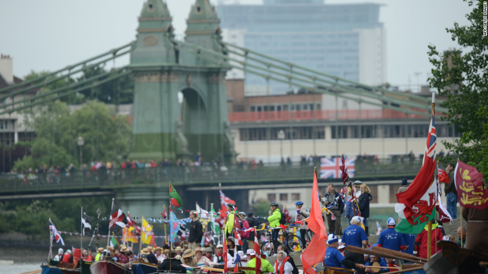 Participants sit in row boats in preparation for the start of the jubilee flotilla along the Thames for the queen's diamond jubilee.