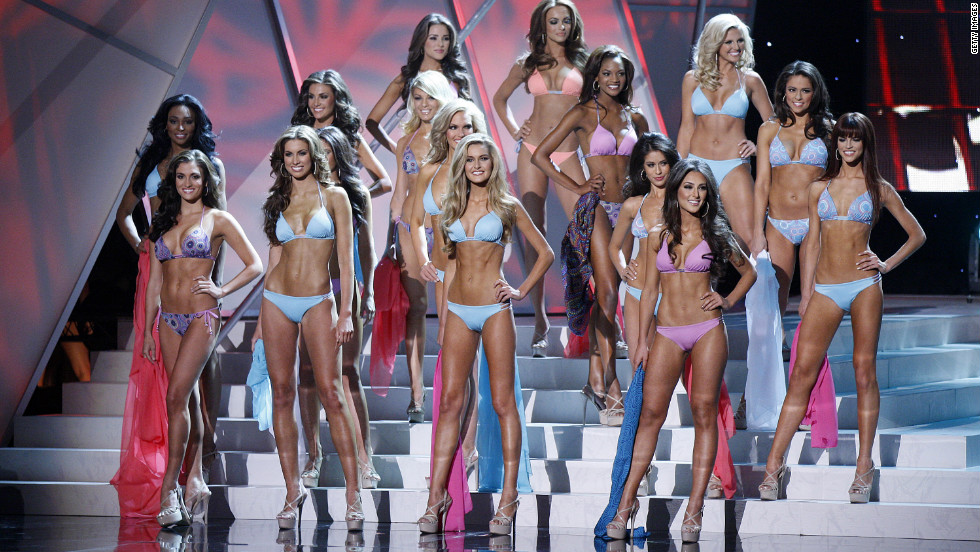 Contestants pose on stage during the swimwear competition of the pageant.