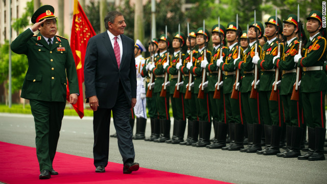 U.S. Defense Secretary Leon Panetta joins Vietnamese Defense Minister Phung Quang Thanh at a ceremony Monday in Hanoi.