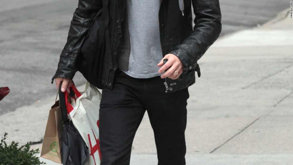 Paul Wesley returns to his hotel in New York City.
