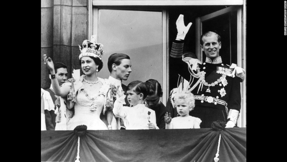 Prince Philip waves from the balcony of Buckingham Palace after his wife officially became queen in June 1953.
