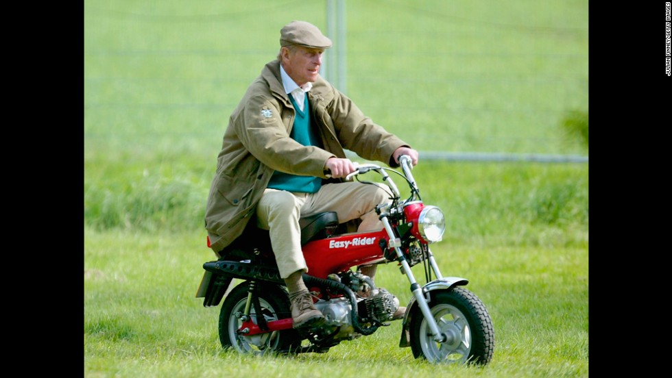 Prince Philip rides a mini motorbike at the Royal Windsor Horse Show in May 2005.