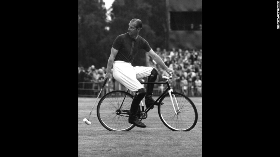 Prince Philip competes in a bicycle polo match in August 1967.