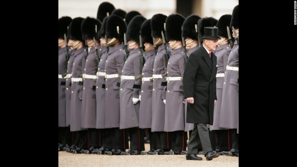 Prince Philip inspects a guard in March 2010.