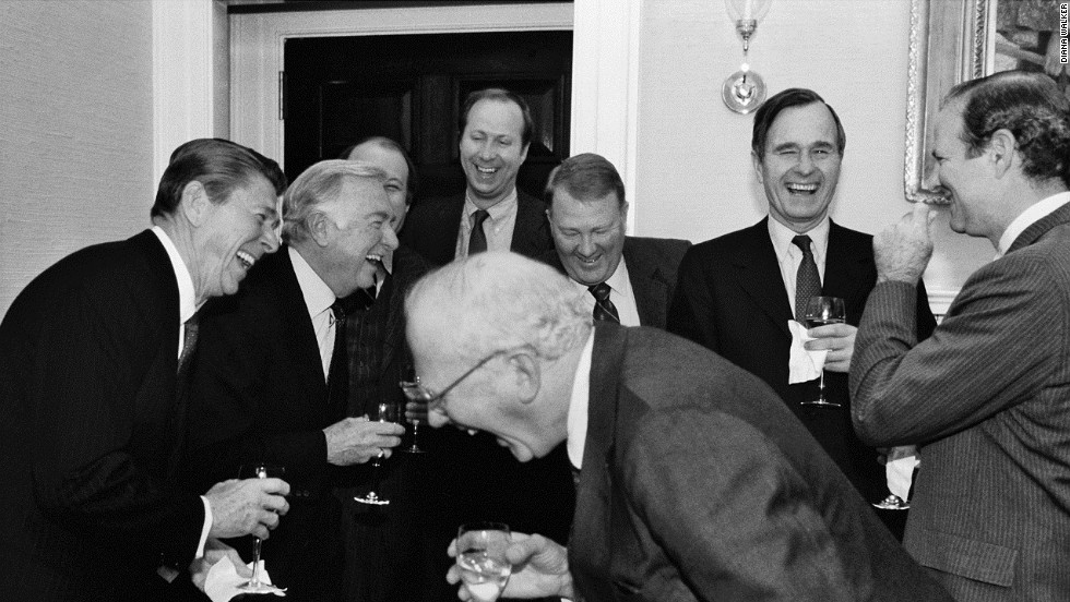 President Reagan, left, Cronkite, presidential staffers Jim Brady and David Gergen, then-Attorney General Ed Meese, then-Vice President George Bush, chief of staff James Baker, and CBS News' Bud Benjamin laugh at a 1981 White House party.