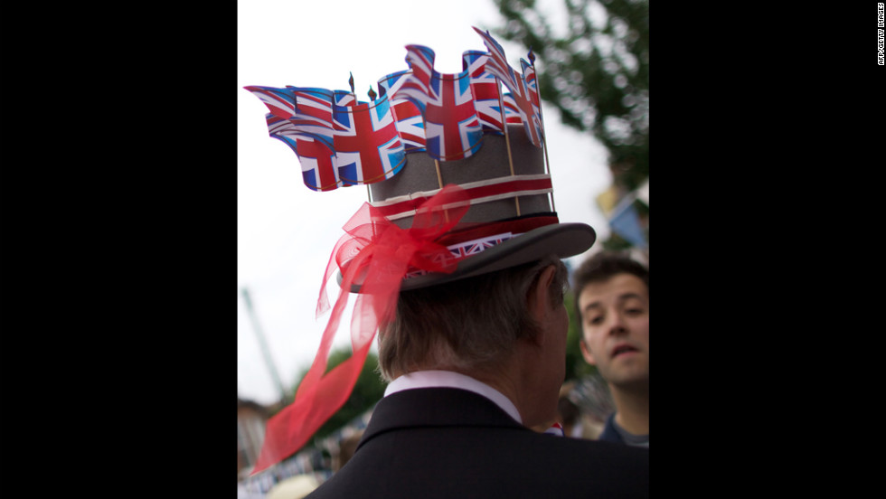 British flags adorn a man's hat as residents of South London's Battersea join in the Jubilee celebration Saturday.