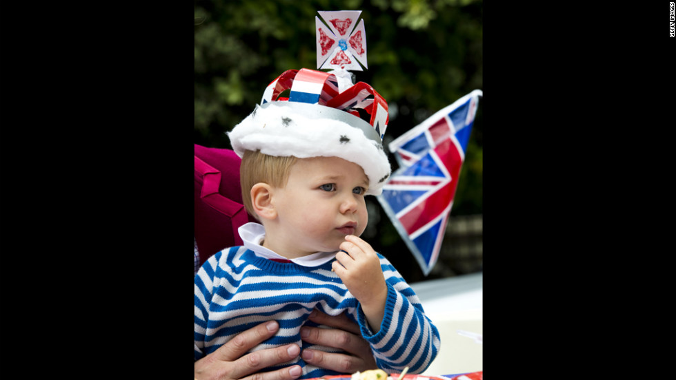 A boy takes in the sights and sound of Jubilee celebrations Monday in London's Kensington neighborhood.