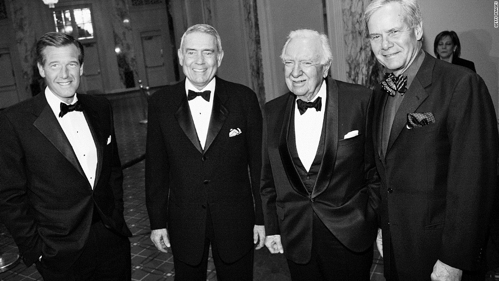 Cronkite poses in 2004 with newsmen Brian Williams, left, Dan Rather and Tom Brokaw.