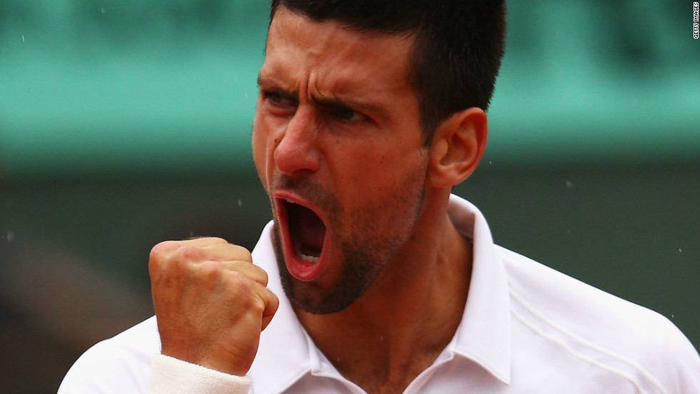 Novak Djokovic roars with relief after coming through his five-set quarterfinal against French Open crowd favorite Jo-Wilfried Tsonga at Roland Garros.