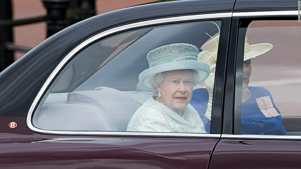 Queen Elizabeth II and Diana Marion, The Lady Farnham, drive down the Mall on their way to St Paul's Cathedral.