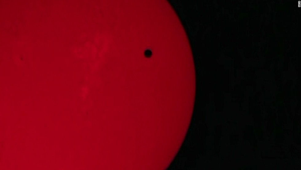Venus transiting in front of the Sun.