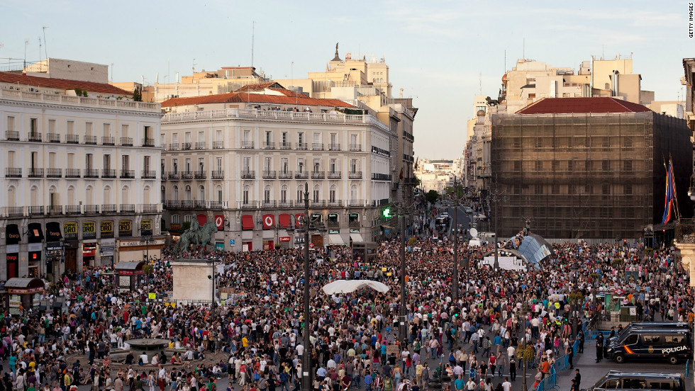 Protesters with Spain's Indignant movement attend a rally at Puerta del Sol on May 15, 2012 in Madrid, Spain. The movement  was formed to protest against the economic crisis and high unemployment.