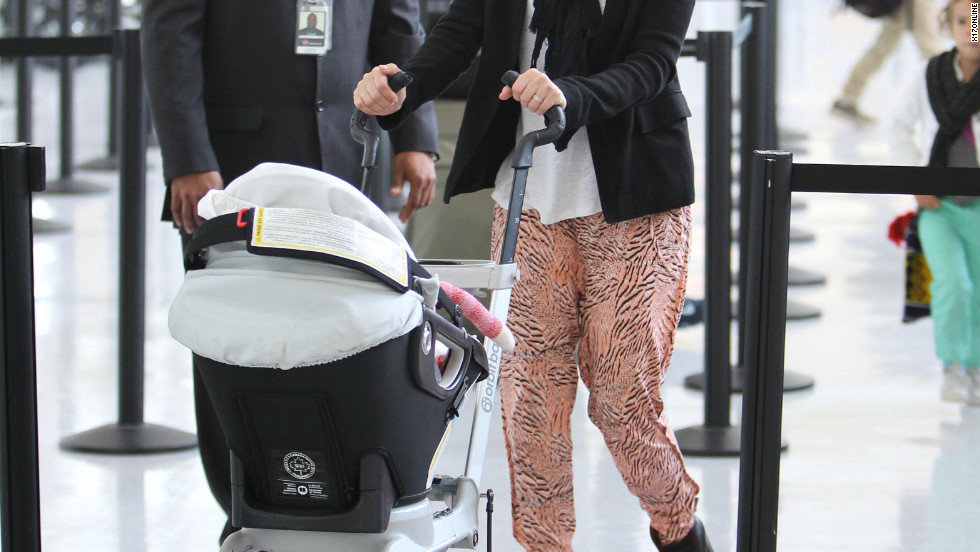 Jessica Alba catches a flight with her family from New York City.