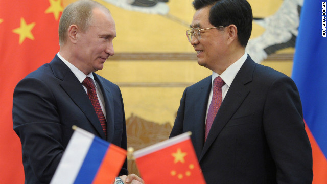 Chinese President Hu Jintao and his Russian counterpart Vladimir Putin shake hands during a signing ceremony at the Great Hall of the People in Beijing on June 5, 2012.