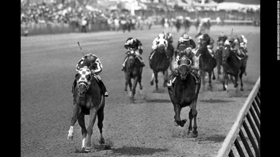 Secretariat, left, heads to victory at the Kentucky Derby in 1973. Considered by many to be the greatest racehorse of all time, Secretariat still holds the record for the fastest times in all three Triple Crown races. He won the Belmont by an astounding 31 lengths.