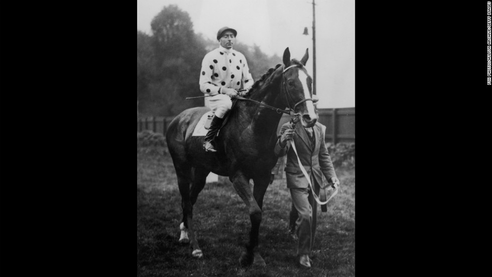 Jockey Pat Beasley rides Omaha in 1936. The horse won the Triple Crown in 1935.
