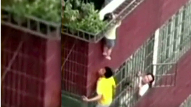 Toddler dangles by head from 4th floor