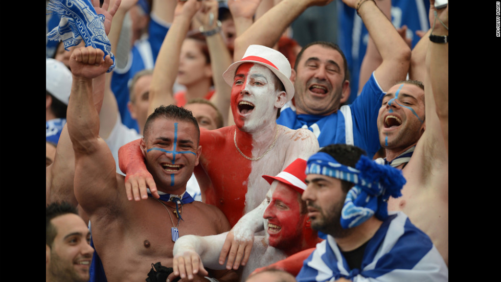 Greek and Polish fans cheer for their teams before the match.