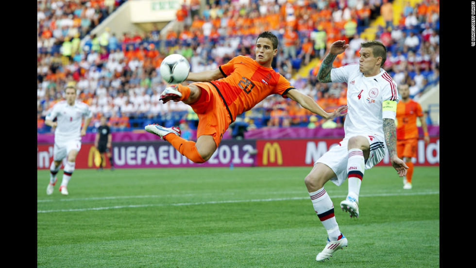 Ibrahim Afellay of the Netherlands goes airborne as Daniel Agger of Denmark defends.