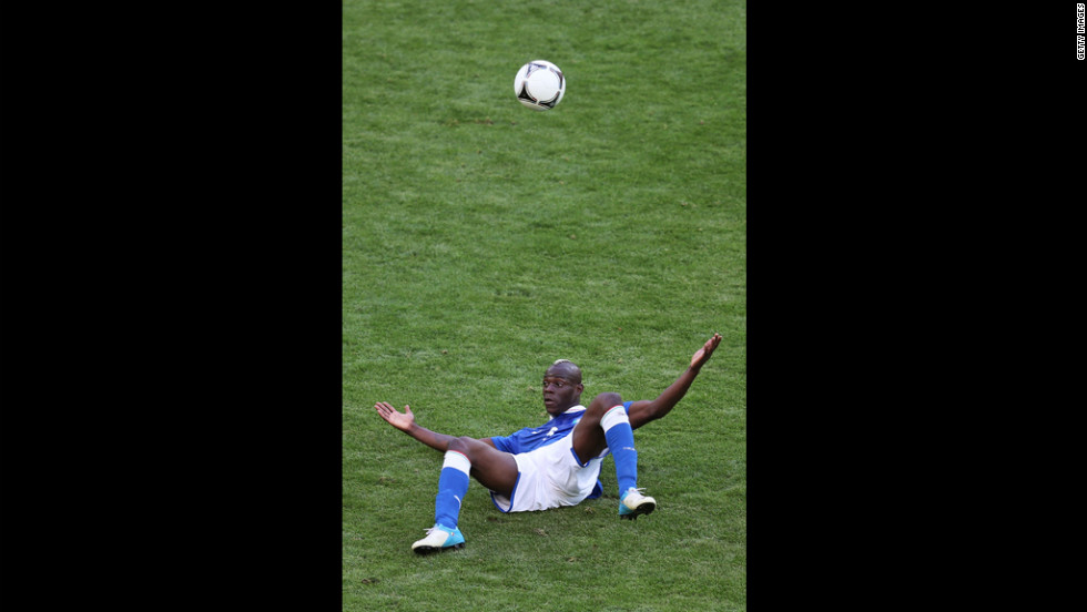 Italy's Mario Balotelli looks up after a fall during the Spain-Italy match.