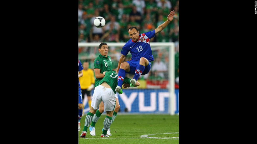 Gordon Schildenfeld of Croatia clashes with Kevin Doyle of Ireland.