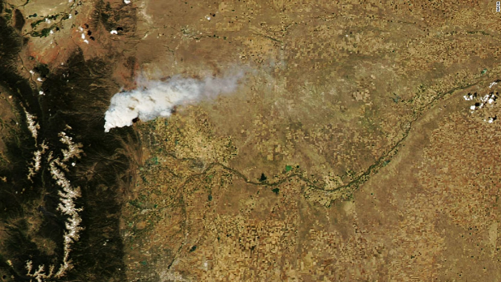 A satellite image from NASA shows a plume of smoke from the High Park Fire about 20 miles northwest of Fort Collins on June 9.
