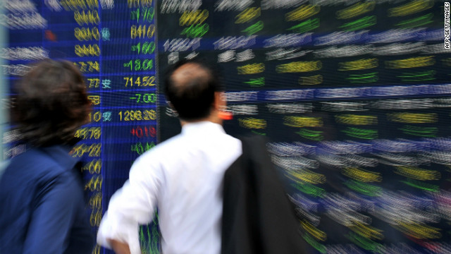 A businessman gazes at a share prices board in Tokyo on June 8, 2012. Japan's share prices dropped 180.46 points to close at 8,459.26 points at the Tokyo Stock Exchange, despite positive Japanese economic growth data and China's decision to cut interest rates.