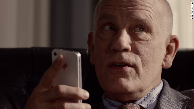 Actor John Malkovich talks to his iPhone 4S in a current TV ad for Apple.