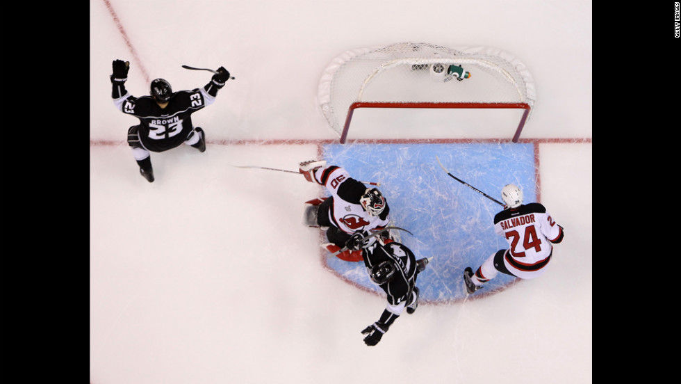 Dustin Brown, left, of the Kings reacts after scoring on a deflection against the Devils.