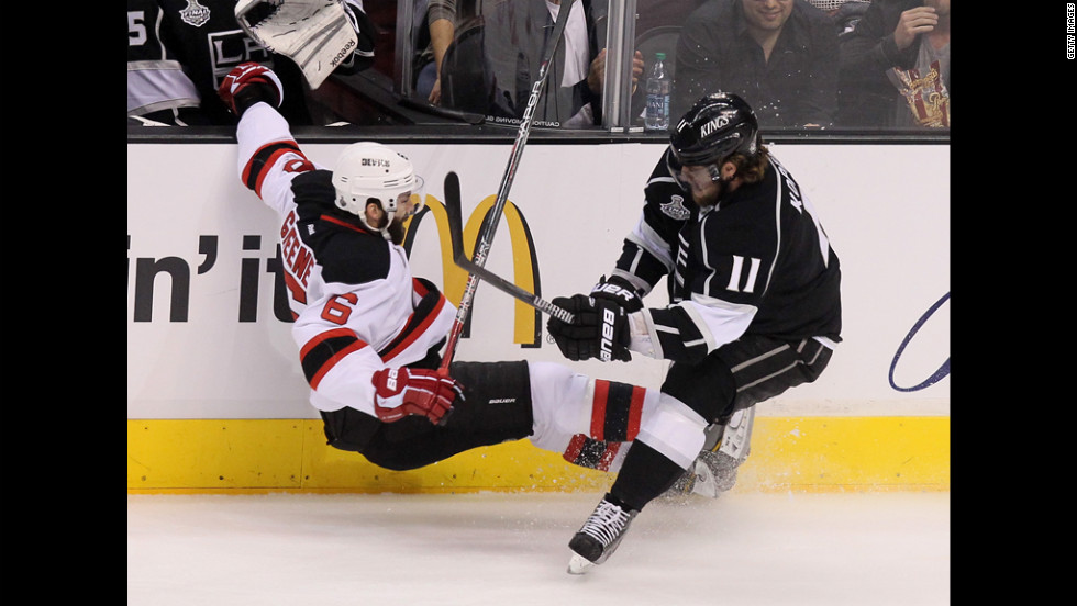 Anze Kopitar of the Kings collides with the Devils' Andy Greene.