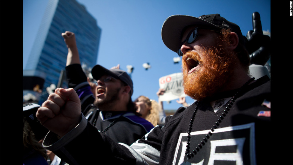 Fans rally in front of the Staples Center before the start of the game.