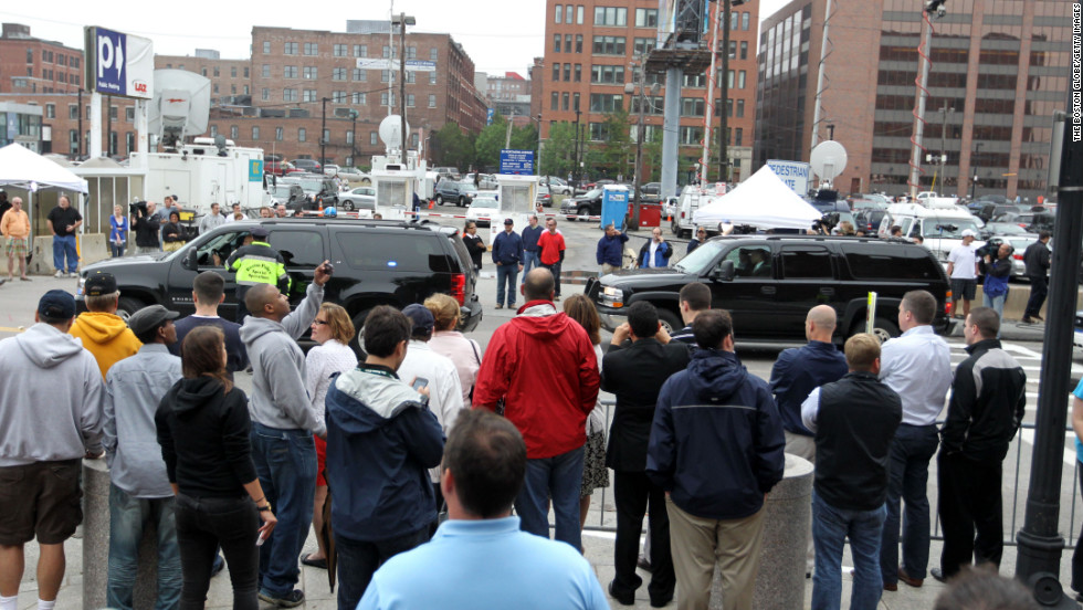 Spectators and press crowd in front of the John Joseph Moakley courthouse in Boston as Bulger and Greig arrive for arraignment on June 24, 2011.
