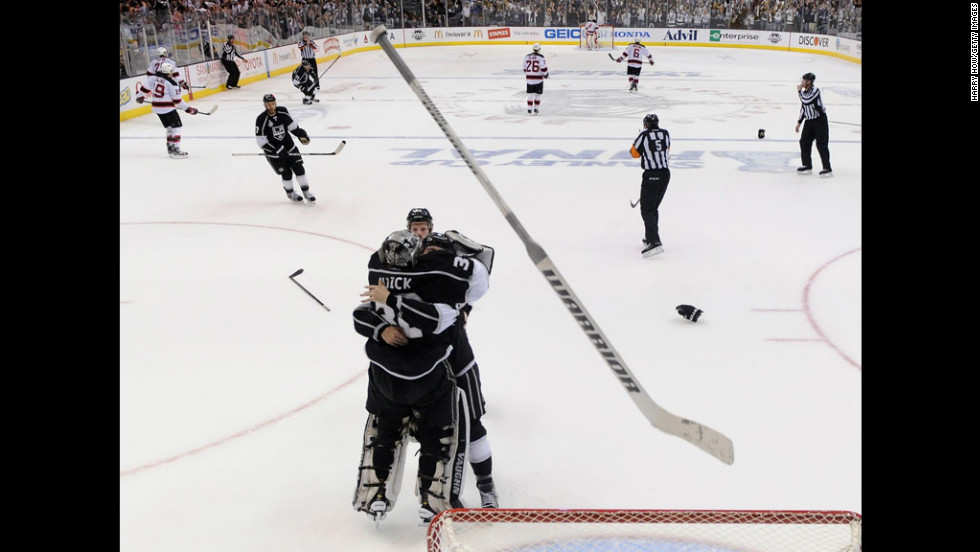 Los Angeles Kings players Drew Doughty, Jonathan Quick and Colin Fraser celebrate the Kings' 6-1 victory over the New Jersey Devils Monday night that clinched the Stanley Cup.
