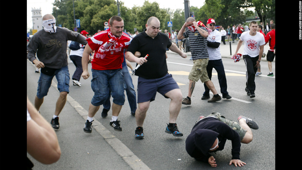 Polish and Russian soccer fans clash outside of the National Stadium in Warsaw.