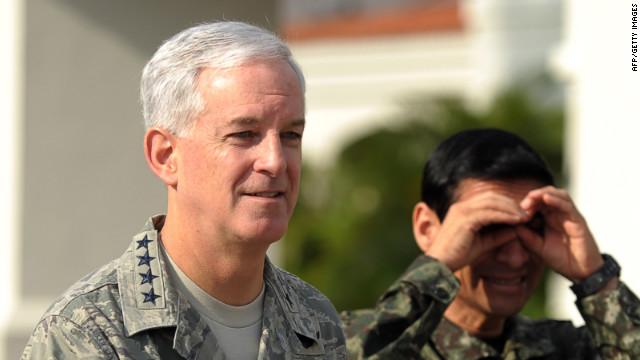 General Douglas Fraser (L), will decide how to proceed in an investigation of alleged misconduct by U.S. troops in Colombia.