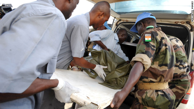 UN troops carry on a stretcher the body of one of the seven UN peacekeepers from Niger who were killed in an ambush, at the airport in Abidjan on June 9, 2012. Eight civilians died in Ivory Coast in raids near the Liberian border that also killed seven UN peacekeepers and sparked an exodus of thousands from the area, the United Nations said on June 9. Ivory Coast's west, by far the most unstable part of the country, has been plagued by deadly attacks since a political and military crisis started in late 2010, leaving some 3,000 people dead throughout the country.  AFP PHOTO / STR        (Photo credit should read STR/AFP/GettyImages)