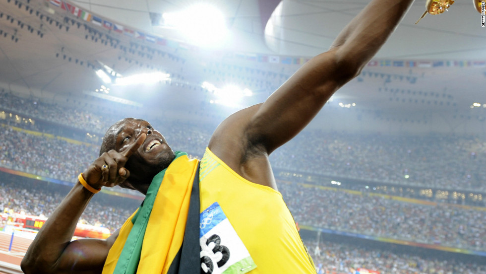 Usain Bolt strikes his trademark pose after claiming gold in the 100 meters at the 2008 Beijing Olympics.
