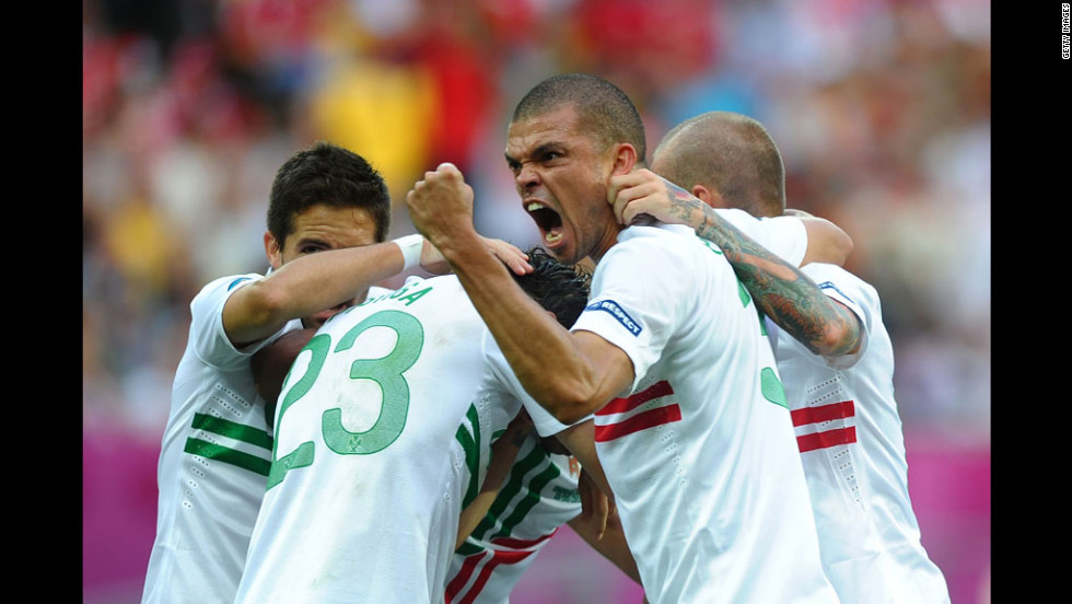 Pepe celebrates after Helder Postiga of Portugal scored the second goal against Denmark.